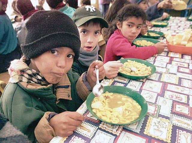 Hungry children at government sponsored food kitchen