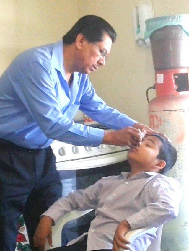 Dr. Alvarez examining Ramon