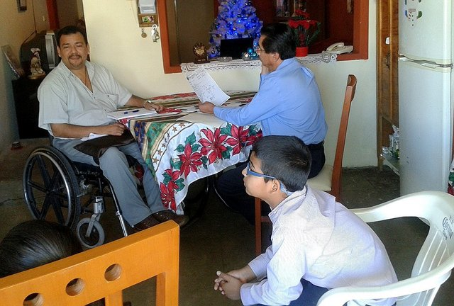 Rigo (in wheelchair) arranged for Dr. Miguel Angel to examine Ramon in Rigo's sister's house in Culiacan
