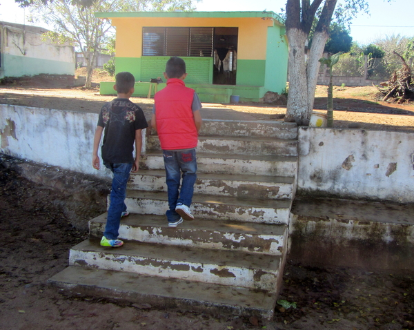 The first, lower set of steps to reach the schoolhouse