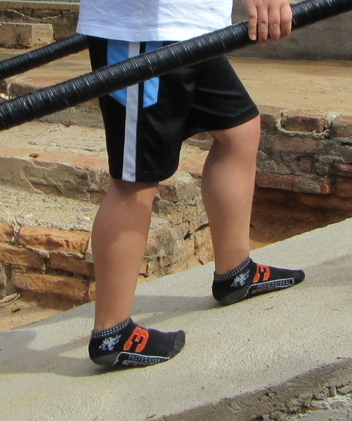 Walking up ramp helps stretch his tight heel-cords, which may allow the boy to keep walking longer.