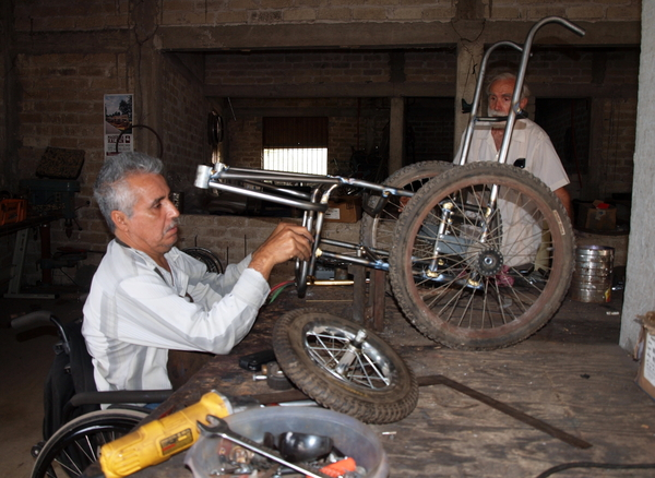 Raymundo, in the PROJIMO Duranguito workshop, working on the wheelchair carriage for Tonio.